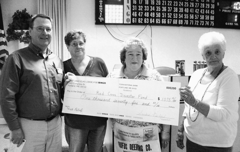 A $1,075 check to benefit Haiti is presented by Elks No. 188. From left are Dave Thompson of the Red Cross, and Joanne Gagnon, Diana Jenkins and Lorraine Cavallaro of Elks No. 188.