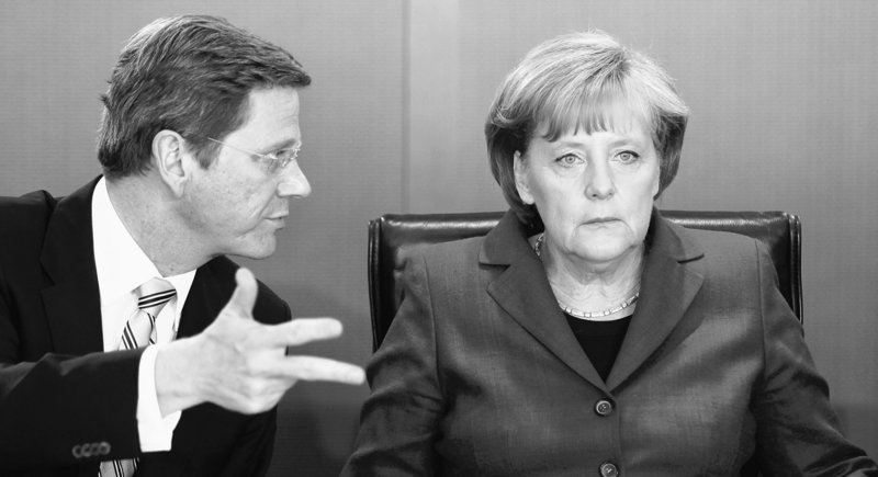 Germany's Angela Merkel, right, is seen with Foreign Minister Guido Westerwelle at a meeting in Berlin on Wednesday.
