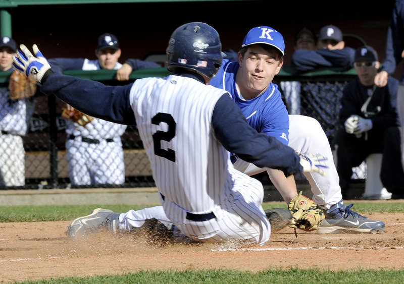 Ben Dibiase of Portland is out at the plate while trying to score from third base on a pitch that got away Thursday. Pat Fulford of Kennebunk applies the tag. Portland improved to 2-0 with a 4-1 victory at Hadlock Field.