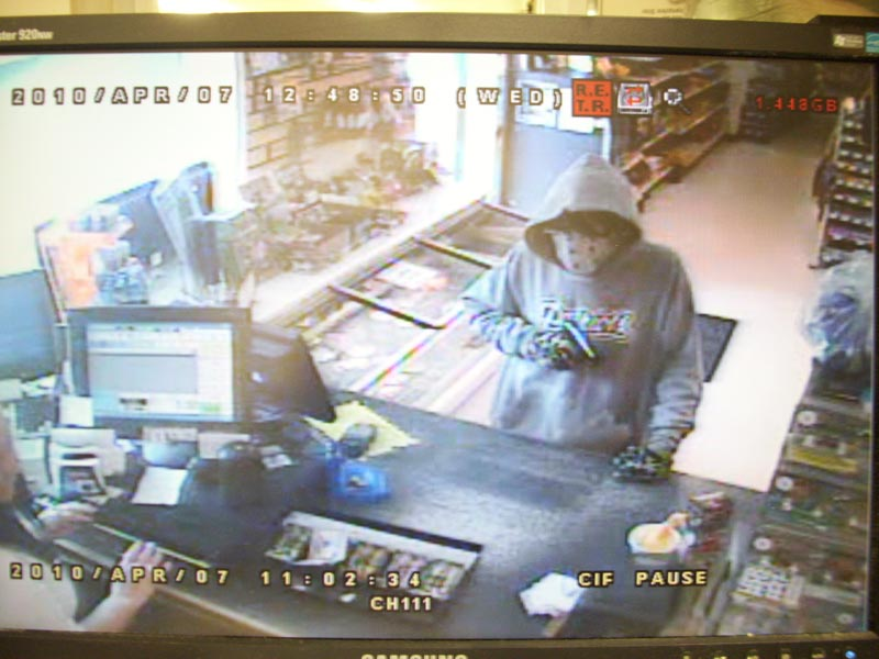 A security photo of a suspect in an armed robbery at Tabor's Variety Store on Ossippee Trail West in Standish yesterday, April 7. The suspect escaped on a bicycle.