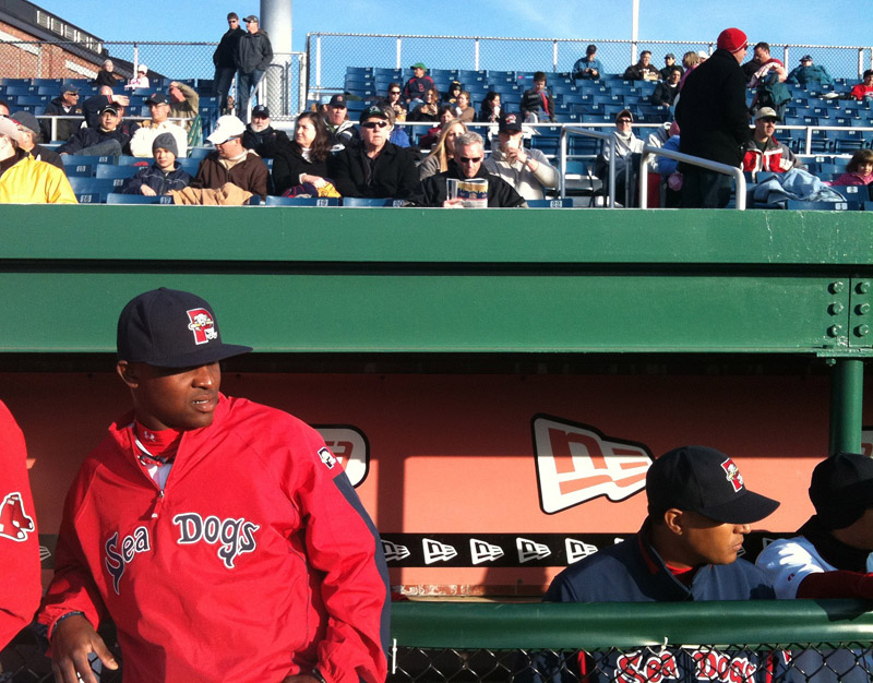 Pitcher Jason Rice, left, waits for the start of the Sea Dogs game tonight against the Trenton Thunder. The Dogs are coming off a season-opening, weeklong road trip with a 4-3 record.
