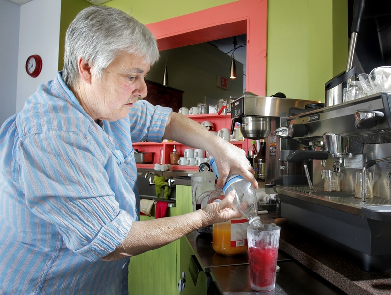 Jo Moser makes a pomegranate spritzer at her Greenlight Studio.