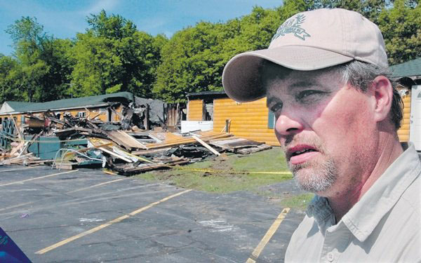 Grandview Coffee Shop owner Donald Crabtree speaks outside his topless restaurant that was destroyed by fire early Wednesday June 3, 2009, morning.