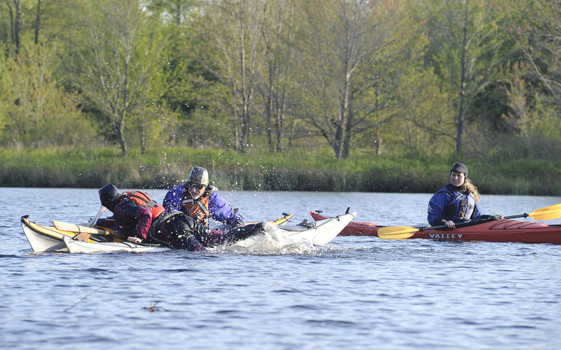 Outdoor writer Shannon Bryan, on right, gets kayak instructions from Theresa Ouellette of Coastal Maine Kayak and fellow guide Ernie Forgione on the water at Highland Lake in Falmouth.