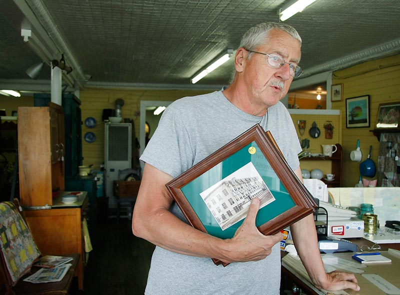 Don Engstrom of Dixmont, an employee at Traditions, an antique shop at the center of Corinna, reminisces about his employment at the Eastland Woolen Mill back in the 1970s.