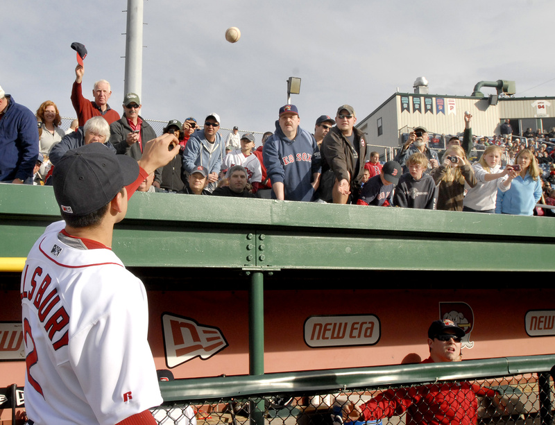 An autograph-seeking fan tosses a ball to Jacoby Ellsbury of the Boston Red Sox before Tuesday night's Sea Dogs game at Hadlock Field in Portland. Ellsbury, recovering from a rib injury, was in the lineup for the Sea Dogs against the New Britain Rock Cats.