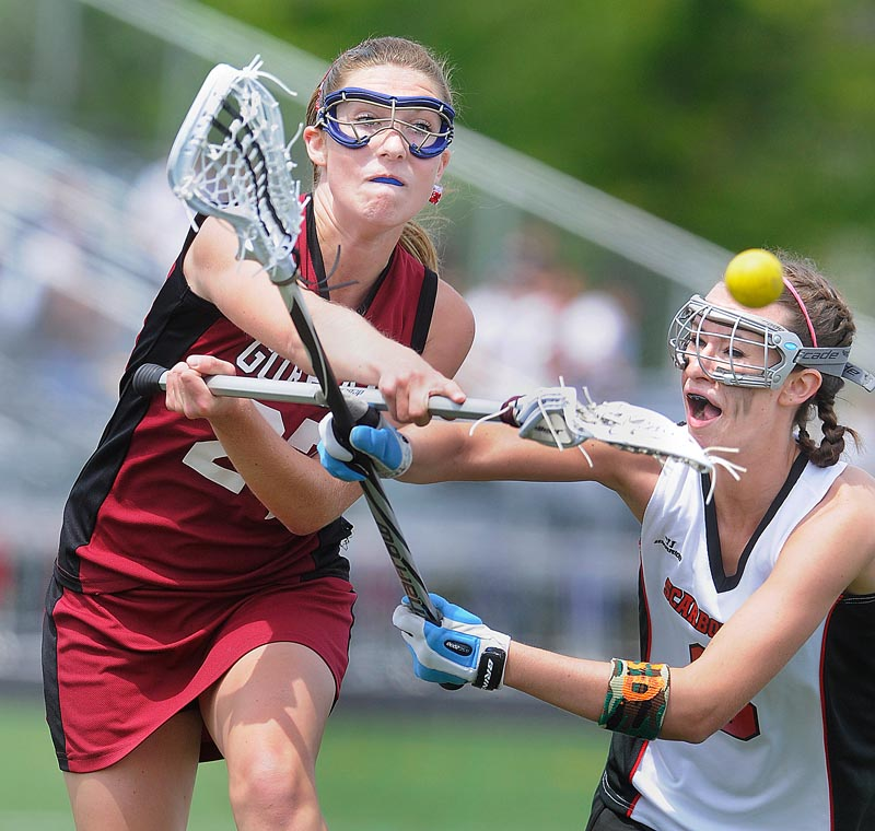 Mia Rapolla of Gorham fires a shot past Dani Foster of Scarborough for one of her nine goals Saturday during a schoolgirl lacrosse game. Scarborough emerged with a 17-15 victory.