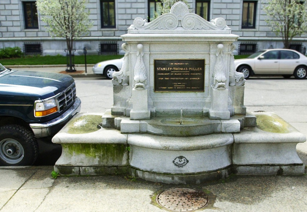 Staff Photo by Gordon Chibroski, Wed, May 09, 2001: This Stanley Pullen Memorial Fountain on Federal St. gets no respect as a pickup truck is parked so close, the monument is embedded into the license plate at the corner that is broken off Gordon Chibroski