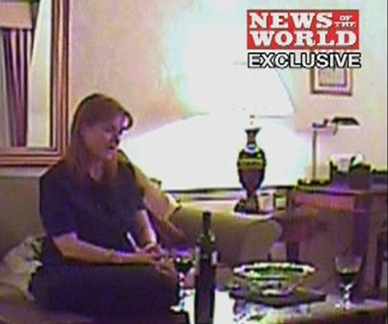 This image from video, made available by British newspaper News Of The World, purports to show Britain's Duchess of York Sarah Ferguson apparently offering to sell access to her ex-husband Prince Andrew in return for 500,000 pounds ($724,000), in London on an undisclosed date.