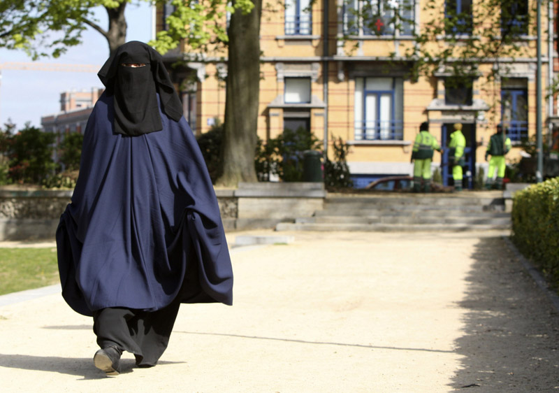 In this April 22 photo, a woman wears the niqab as she walks in a park in Brussels.