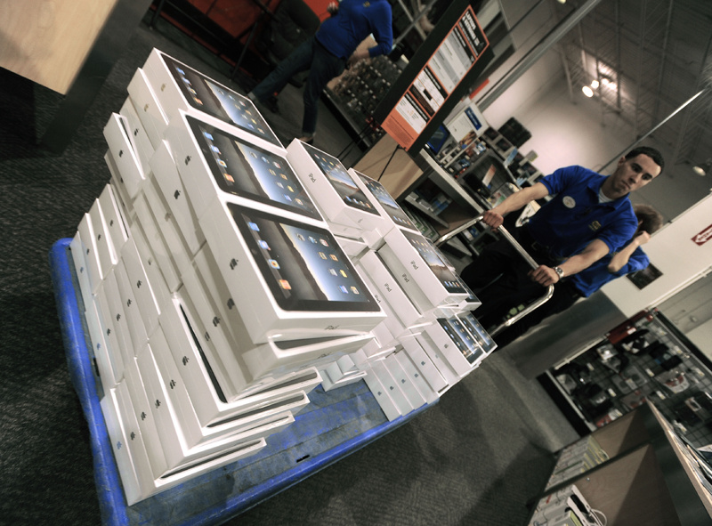 Best Buy employee Edwin Valadez brings Apple iPads out to be stocked on store shelves in Chicago. In the first quarter, consumers spent more on home furnishings and appliances, recreational goods and vehicles, clothing and entertainment.
