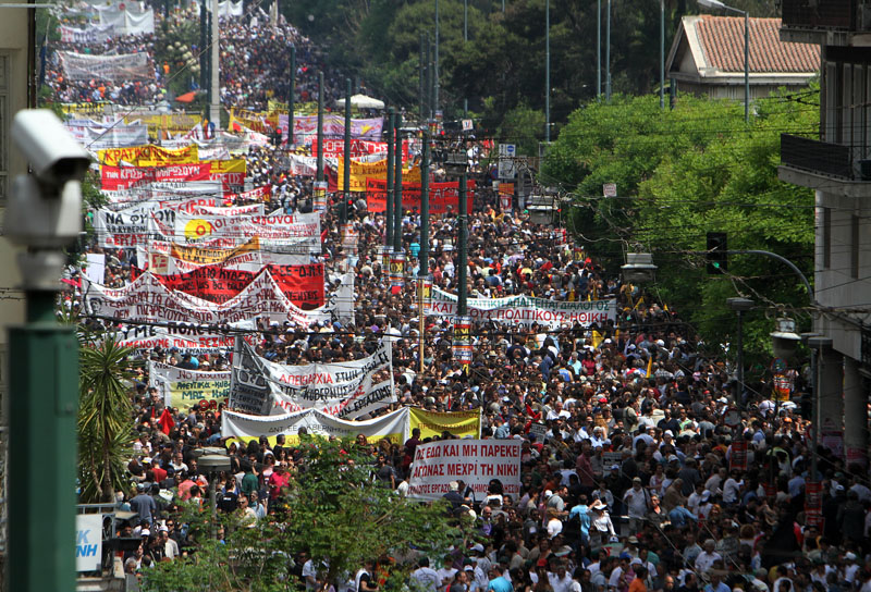 At estimated 100,000 protesters take to the streets in Athens.