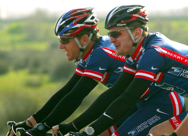 This 2004 file photo shows Lance Armstrong, left, and Floyd Landis riding side-by-side during the second stage of the Tour of the Algarve cycling race in Algarve, southern Portugal. Landis has admitted to systematic use of performance-enhancing drugs and accused seven-time Tour de France champion Lance Armstrong of involvement in doping, the Wall Street Journal reports.