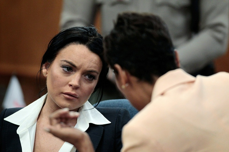 Actress Lindsay Lohan, left, talks to her attorney Shawn Chapman Holley during a hearing in Beverly Hills, Calif., on Monday. celebrities film Los Angeles County Los Angeles Superior Court movies topics topix bestof toppics toppix