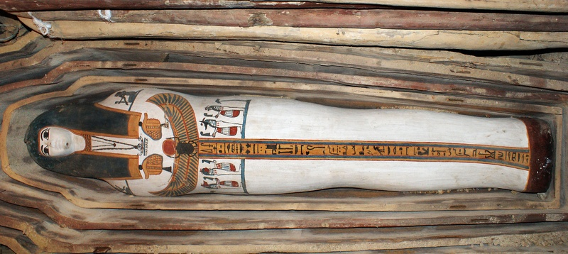 A painted wooden sarcophagus is shown in a photo released by the Egyptian Supreme Council of Antiquities on Sunday. It was discovered in Lahoun, where archaeologists have unearthed 57 ancient Egyptian tombs, with the oldest dating back to around 2750 B.C. and 12 belonging to the 18th dynasty which ruled Egypt during the second millennium B.C.