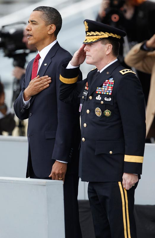 President Obama and Lt. Gen. Franklin Hagenbeck, superintendent at the U.S. Military Academy, stand for the national anthem before a commencement and commissioning ceremony Saturday in West Point, N.Y.