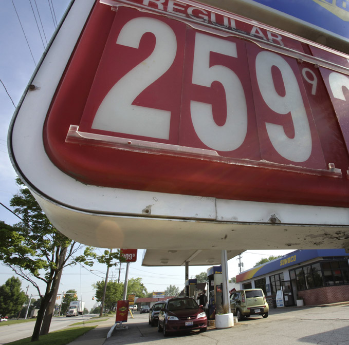 The price of a gallon of unleaded regular gasoline appears on the sign in front of a Sunoco gas station in Bedford, Ohio. Motorists will catch a break at the gas pump as they head out for the Memorial Day weekend.