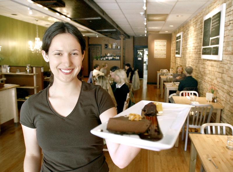 Katie Boone serves up a slice of the Green Elephant's popular vegan chocolate orange mousse. The two eateries serve only vegetarian fare.