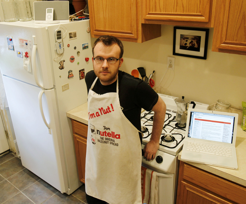 Brian Kraus, who posts a food blog, poses in his kitchen in Albany, N.Y. Kraus loves to cook but has only one cookbook.