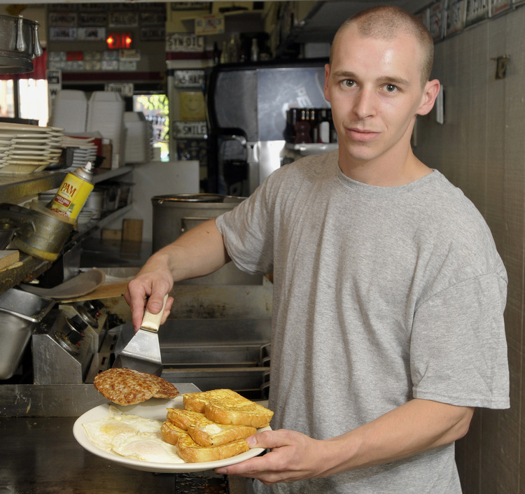 Rob Rollins, cook at the Main Street Cafe, serves up the Slammer, one of the popular breakfast dishes offered all day at the cafe in Westbrook.