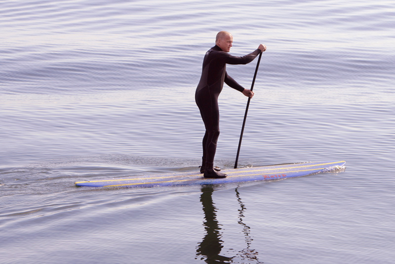 Mark Spaulding of Arundel paddles a paddleboard to East End Beach as part of a protest against offshore oil drilling.