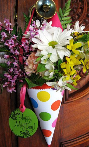 May baskets are traditionally stuffed with flowers and perhaps a small gift and hung from doorknobs.