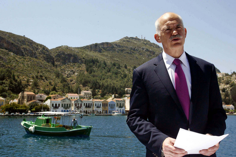 Greek Prime Minister George Papandreou announces Greece's decision to request activation of a joint eurozone-International Monetary Fund financial rescue plan last month, from the main port of the remote southeast Greek Aegean island of Kastellorizo. Greece's crisis raises fears that Portugal and Spain could be next.
