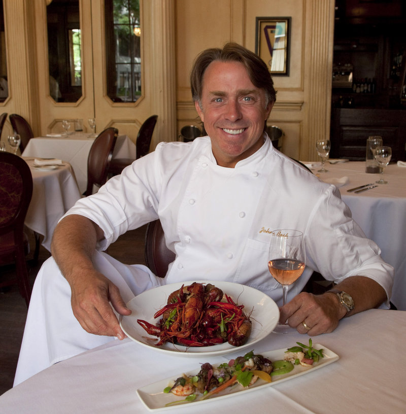New Orleans chef John Besh displays his French crawfish boil, which includes Spanish tarragon and Tennessee truffles, in the kitchen of his restaurant, August.