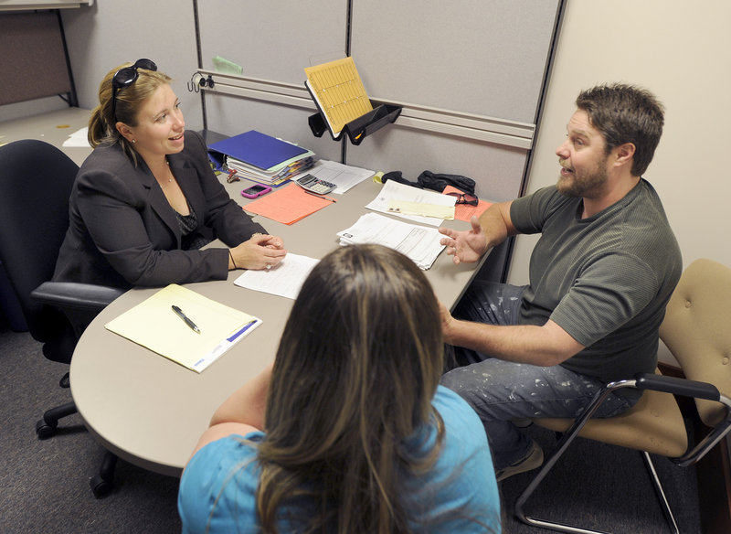 Attorney Alicia Cushing, left, advises Jason Nest on family law issues Thursday. Cushing donated more than 30 hours to the Courthouse Assistance Project over the past year.