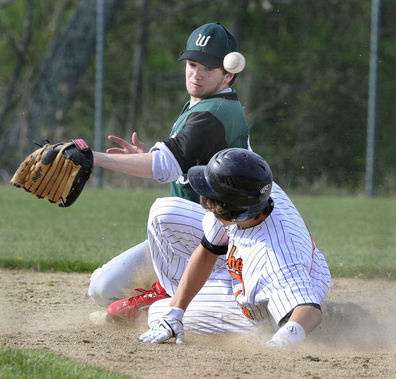 Eli Leavitt of North Yarmouth Academy steals second base Friday as the throw gets away from Noah Aronson of Waynflete during North Yarmouth Academy's 13-2 victory in Portland. High Schools: D5-D6