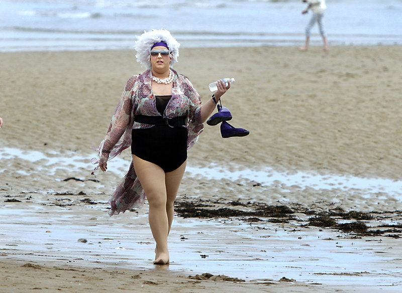 """Drag queen """"E,on,"""" Benjamin Bernard of Lewiston, participates in the 5K run or walk for AIDS from Ogunquit Beach to Moody Beach and back, part of Ogunquit's Cinco de Mayo celebration. Finishing first was Bob Winn of Ogunquit, with a time of 17:14."""