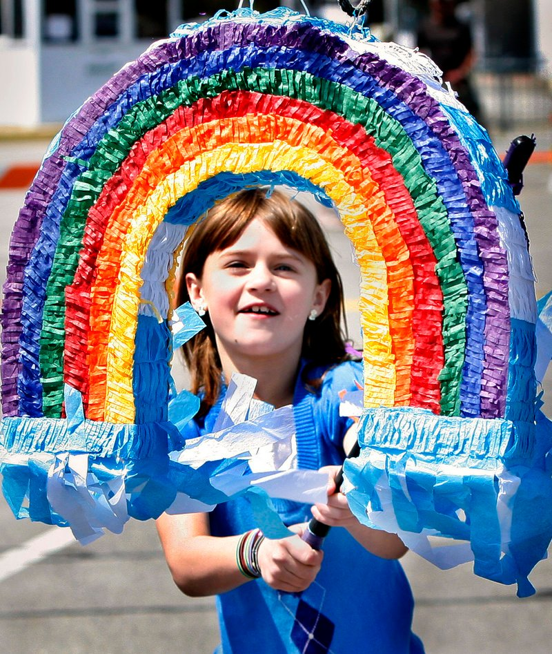 Morgan Sanderson, 8, of Concord, N.H., takes a swing at a pinata during Saturday's beach barbecue.