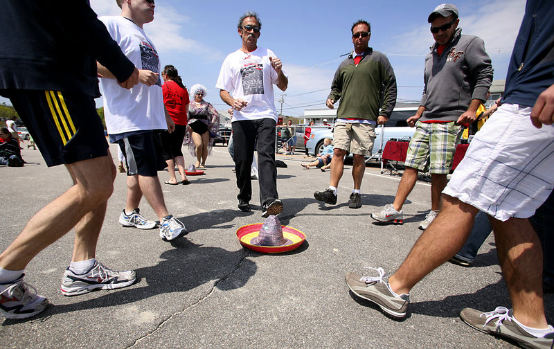 Feet that just finished walking or running 5 kilometers get more of a workout doing the Mexican hat dance at the beach barbecue after the Beach & Bay 5K Run or Walk for AIDS.