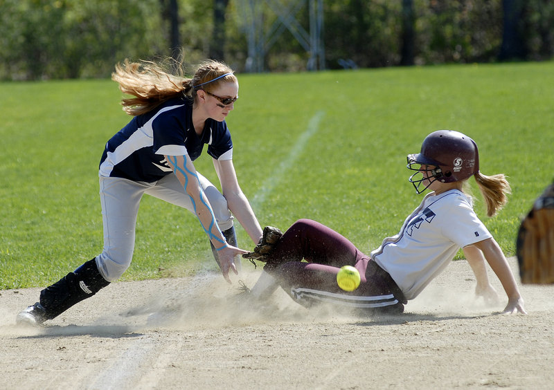 Abbie Hutchinson of Yarmouth reaches for the ball Saturday as Leigh Wyman of Freeport slides into third with a stolen base during Yarmouth's 9-2 victory in a Western Maine Conference softball game at Freeport.