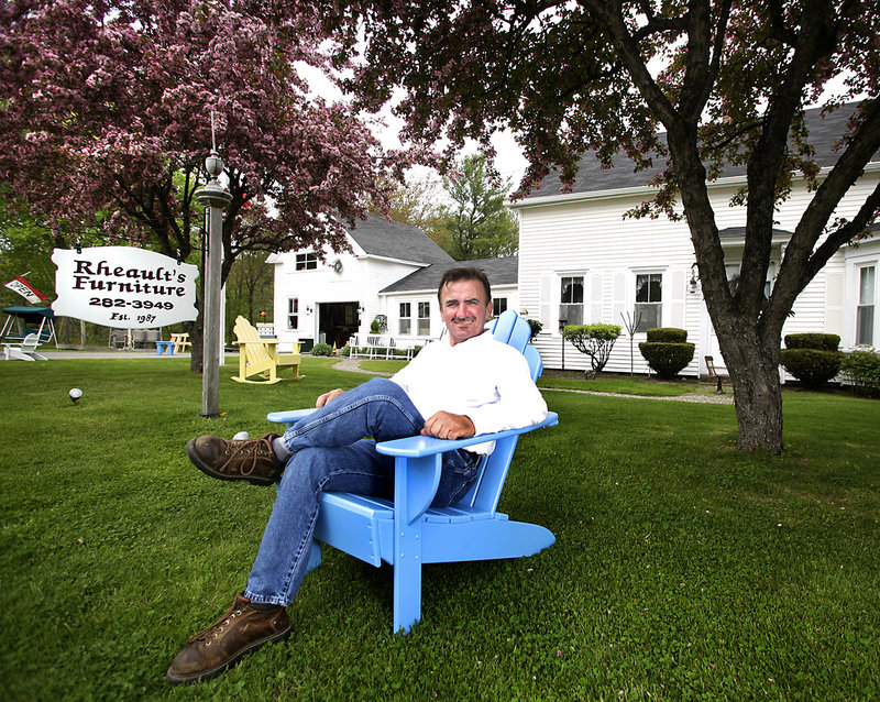 Roger Rheault, owner of Rheault's Furniture, sits in an Adirondack chair he created at his home in Biddeford. Self-taught, he's been making furniture since 1987. He says he enjoys every day of it.