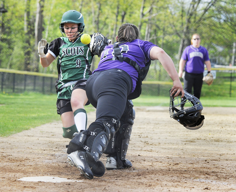 Bonny Eagle's Ashley Usher scores as the throw gets away from Deering catcher Annalisa Ferrante during their SMAA softball game Monday in Portland. Deering overcame a five-run deficit to earn a 9-8 victory.
