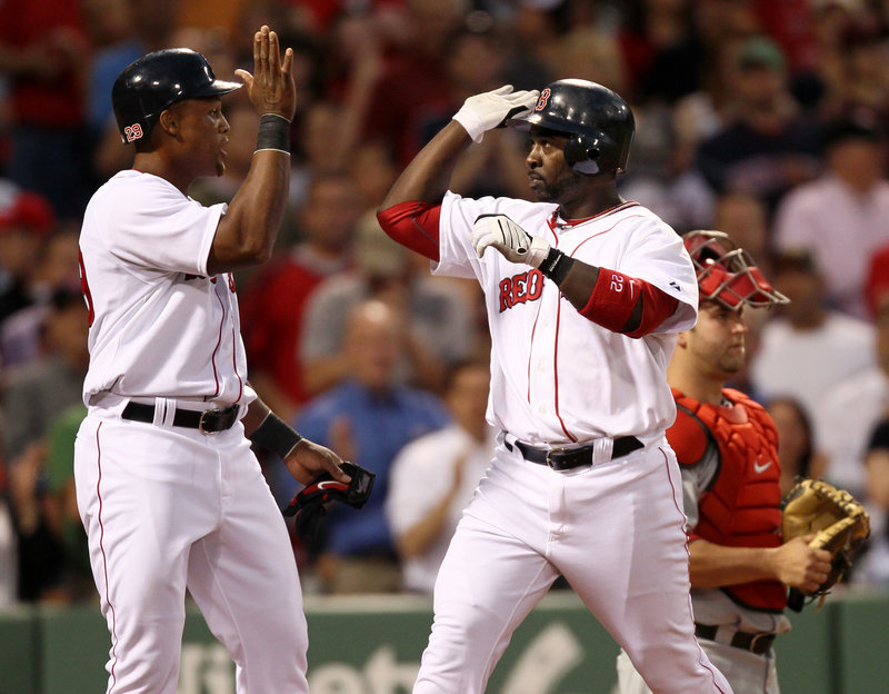Adrian Beltre, left, greets Red Sox teammate Bill Hall at the plate Monday night after Hall's two-run homer in the second inning against the Angels at Fenway Park. Boston won, 17-8.