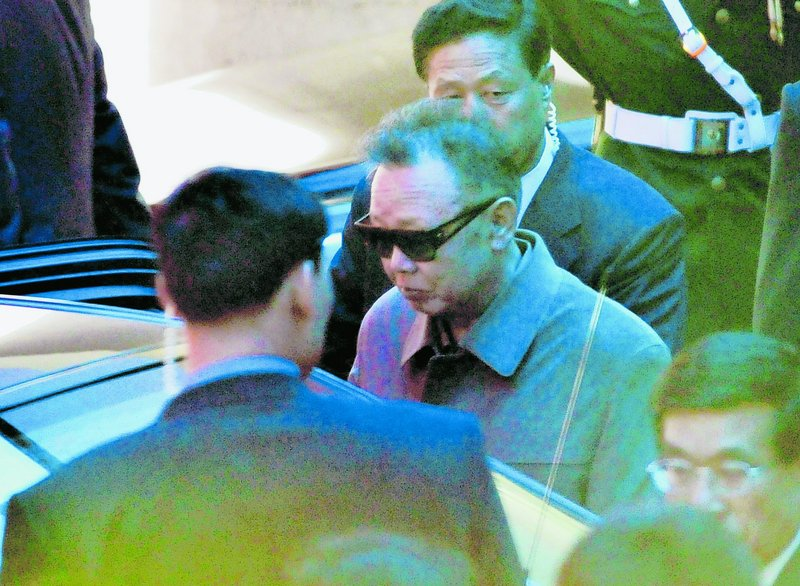 North Korean leader Kim Jong Il, wearing a pair of sunglasses, gets into a vehicle as he leaves a hotel in Dalian, China, on Monday.