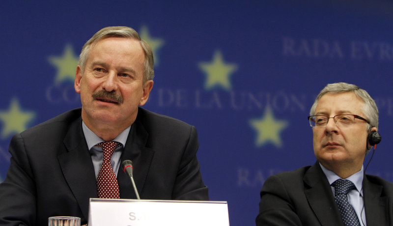 European Transport Commissioner Siim Kallas, left, speaks at a news conference Tuesday after an emergency meeting of EU transport ministers in Brussels, Belgium. At right is Spanish Minister for Transport Jose Blanco Lopez.