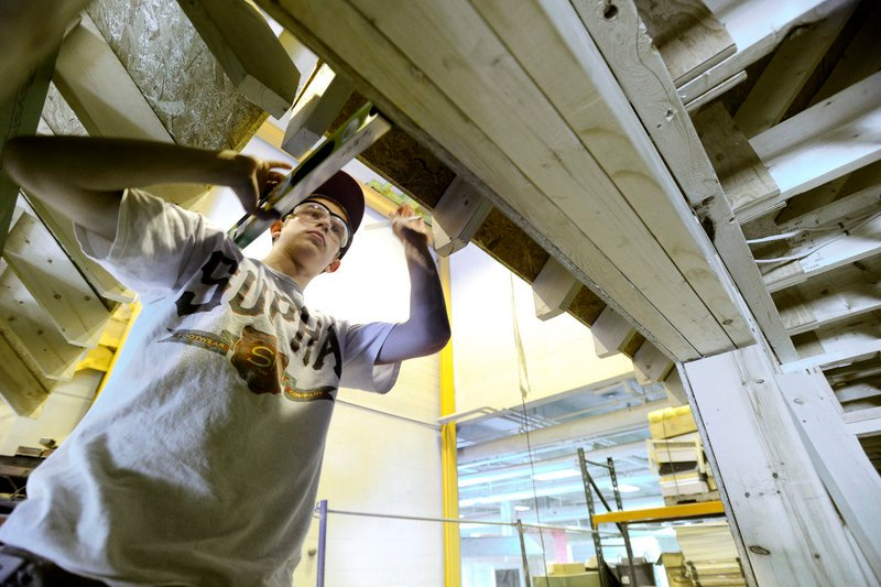 Student Nick Larrivee works Tuesday on a house soffit at PATHS in Portland, which serves about 515 students from 23 public and private schools and educational programs.