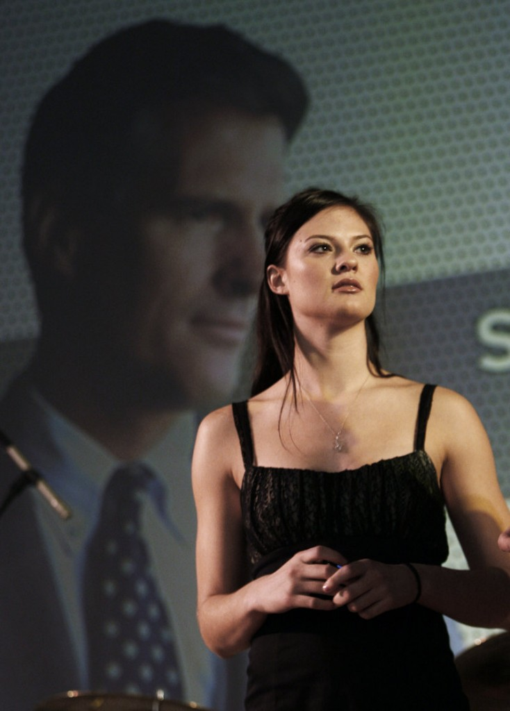 Ayla Brown appears in front of an image of her father, Scott Brown, before he was elected Massachusetts senator.