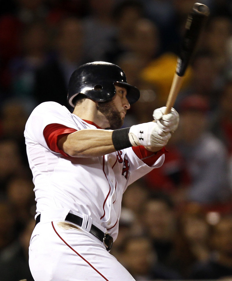 Jeremy Hermida follows through on a three-run double in the eighth inning Tuesday night to help the Red Sox to a 5-1 win over the Angels.