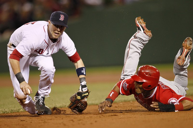 Dustin Pedroia of the Boston Red Sox sets to throw to first to complete a double play after tagging out Erick Aybar of the Los Angeles Angels in the eighth inning Tuesday night – a pivotal play in Boston's 5-1 victory at Fenway Park.