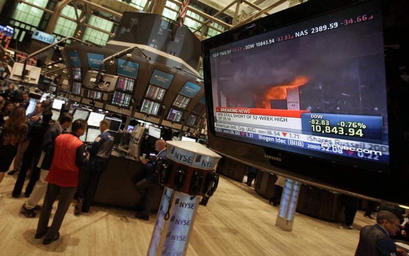 The Associated Press Two lines please A television screen on the floor of the New York Stock Exchange shows unrest in Greece, Wednesday, May 5, 2010.