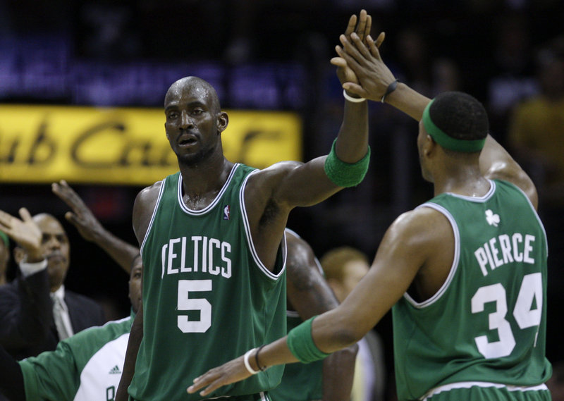 Kevin Garnett of the Boston Celtics, left, suffered a mild strain in the middle of his right foot late in the Game 2 victory Monday night against the Cleveland Cavaliers.