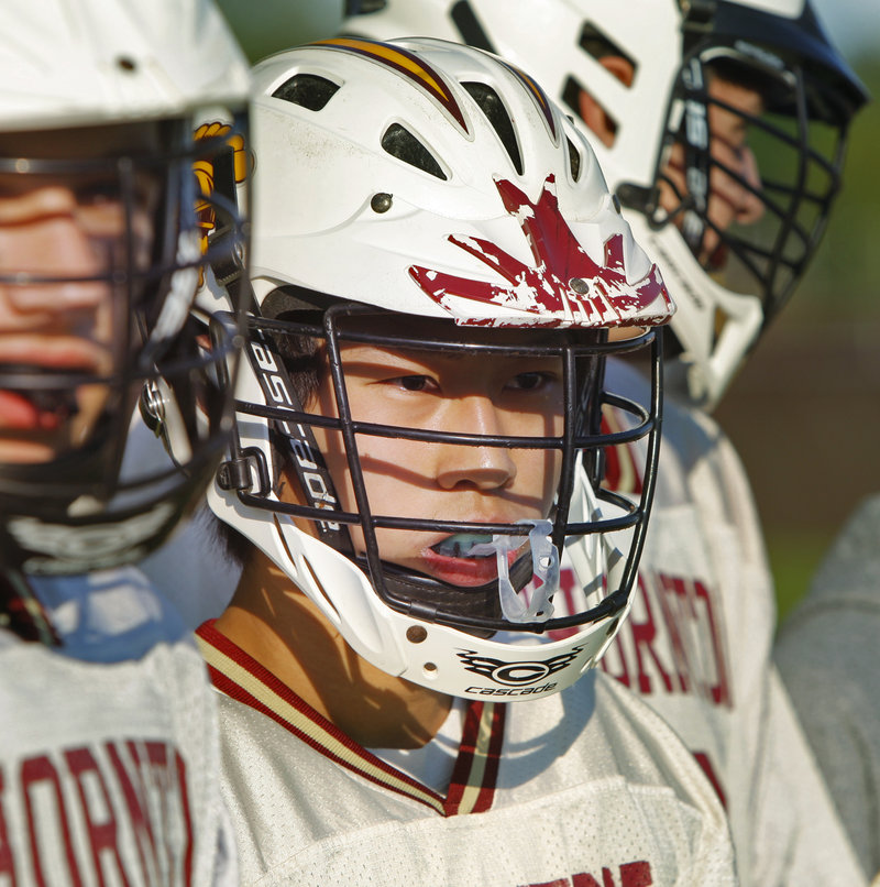 """Chung """"Eric"""" Chan took to lacrosse because it looked exciting and it's not offered in China, and he's getting better at the sport."""