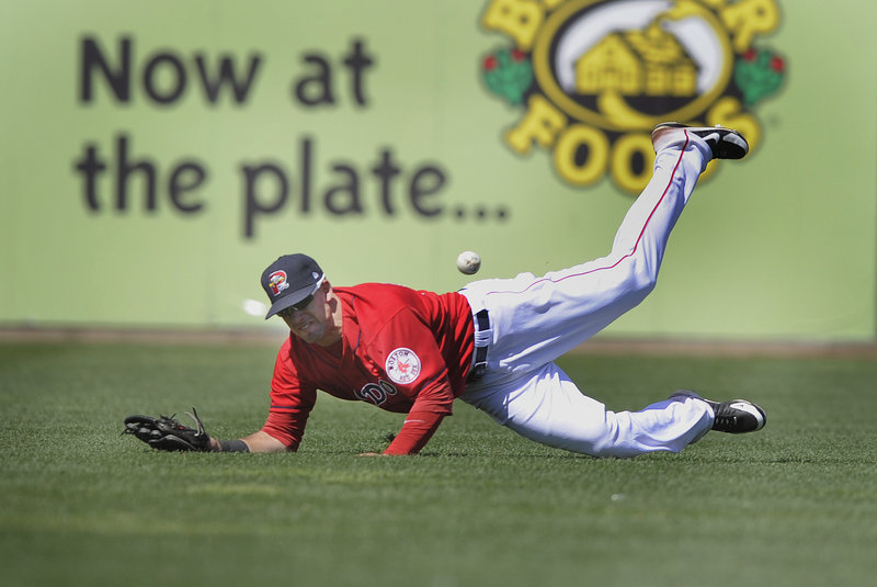 Sea Dogs right fielder Ryan Kalish makes a diving bid but fails to make the catch Thursday at Hadlock Field against the Reading Phillies. Kalish had a two-run single to help Portland rally to a 7-6 victory in the finale of a six-game homestand.