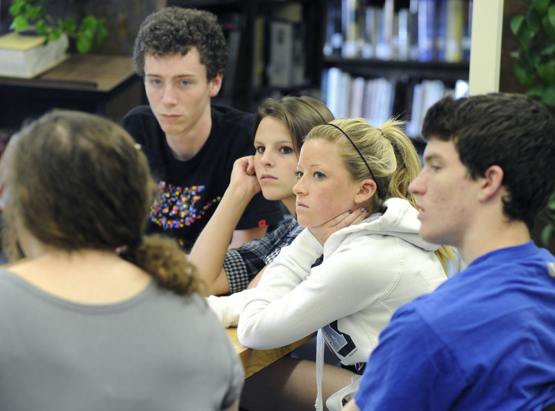 Lake Region seniors, from left, Shep Hayes, Megan Wandishin, Abby Hancock and Zach Tomkinson join a discussion about the state of the school, pictured below. Among the district's goals is a renewed emphasis on improving SAT scores.