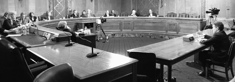 Treasury Secretary Timothy Geithner, right, testifies Thursday on Capitol Hill in Washington before the Financial Inquiry Crisis Commission.