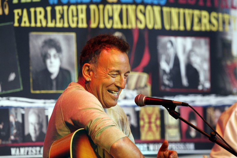 Bruce Springsteen smiles as he sits on stage at Fairleigh Dickinson University on Thursday. Less than a week after his induction into New Jersey's Hall of Fame, rocker Springsteen performed for students at the Madison, N.J., school and talked to them about songwriting.